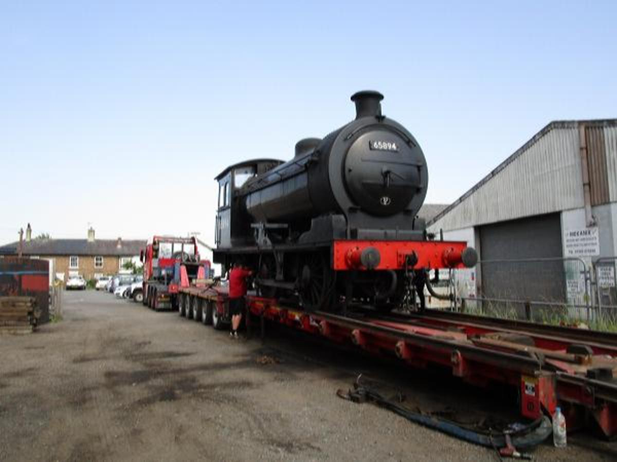 From the front buffer beam end, 65894 is inched slowly down the ramp to be rejoined with her tender
