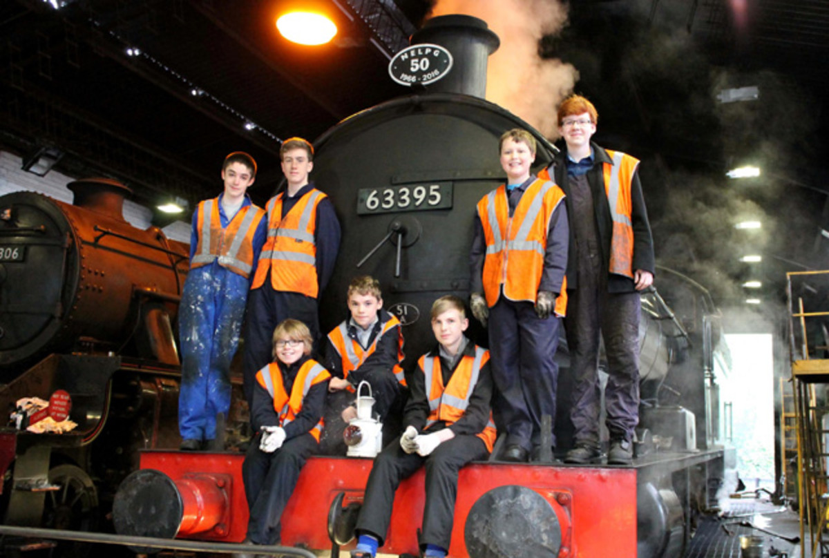 Junior Volunteers - the next generation pose by the smokebox door of 'centenarian' 63395 at Deviation Shed. These are our technicians of the future, learning the terminology and tools used in overhauling a locomotive to take it into the future.