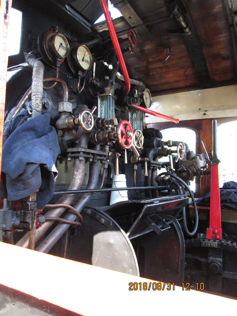 Some of said moving parts on show through the cab side window - fireman's side, featuring the traditional white enamel tea can and cup (with handle, centre), shortly to be joined by one for the driver