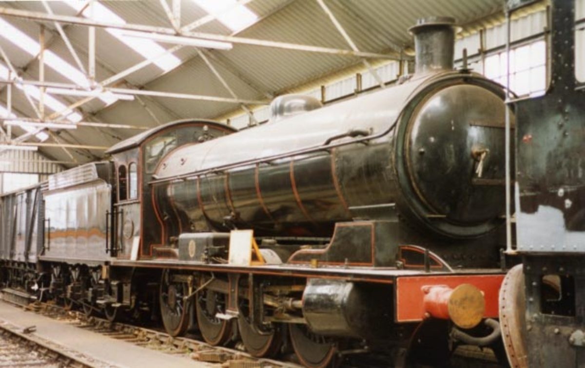 63395 on display with an information board on her running plate  awaits overhaul work at NELPG's shed near Deviation Shed, Grosmont, 1994 (R Pearson)
