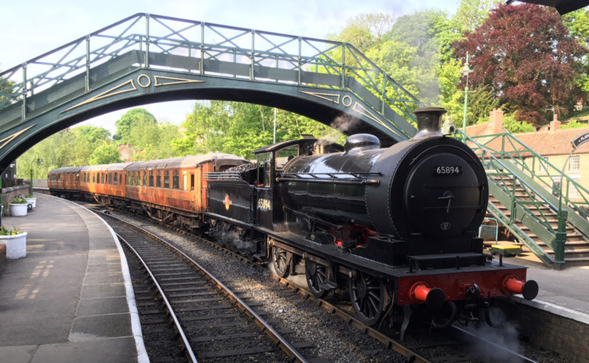 65894 arrives under the footbridge at Pickering on the 'U'p platform and.... (Neal Woods)