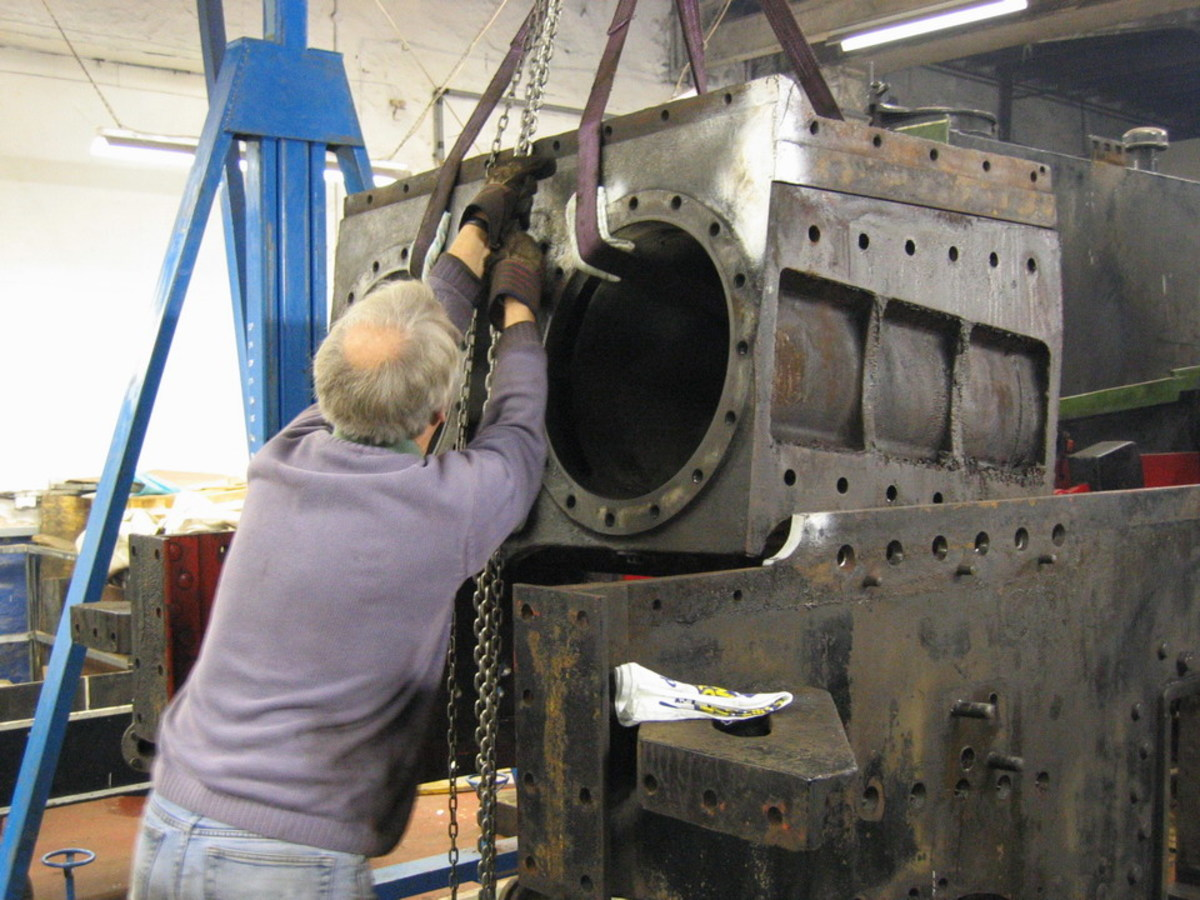 A fracture in the cylinder block was the main reason for work needed, with other jobs arising. Here the cylinder block is lifted from the frames