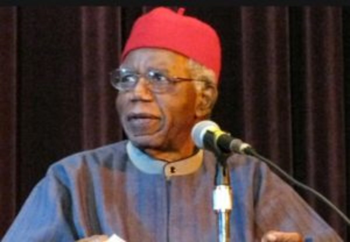 Chinua Achebe wearing an Igbo red hat -