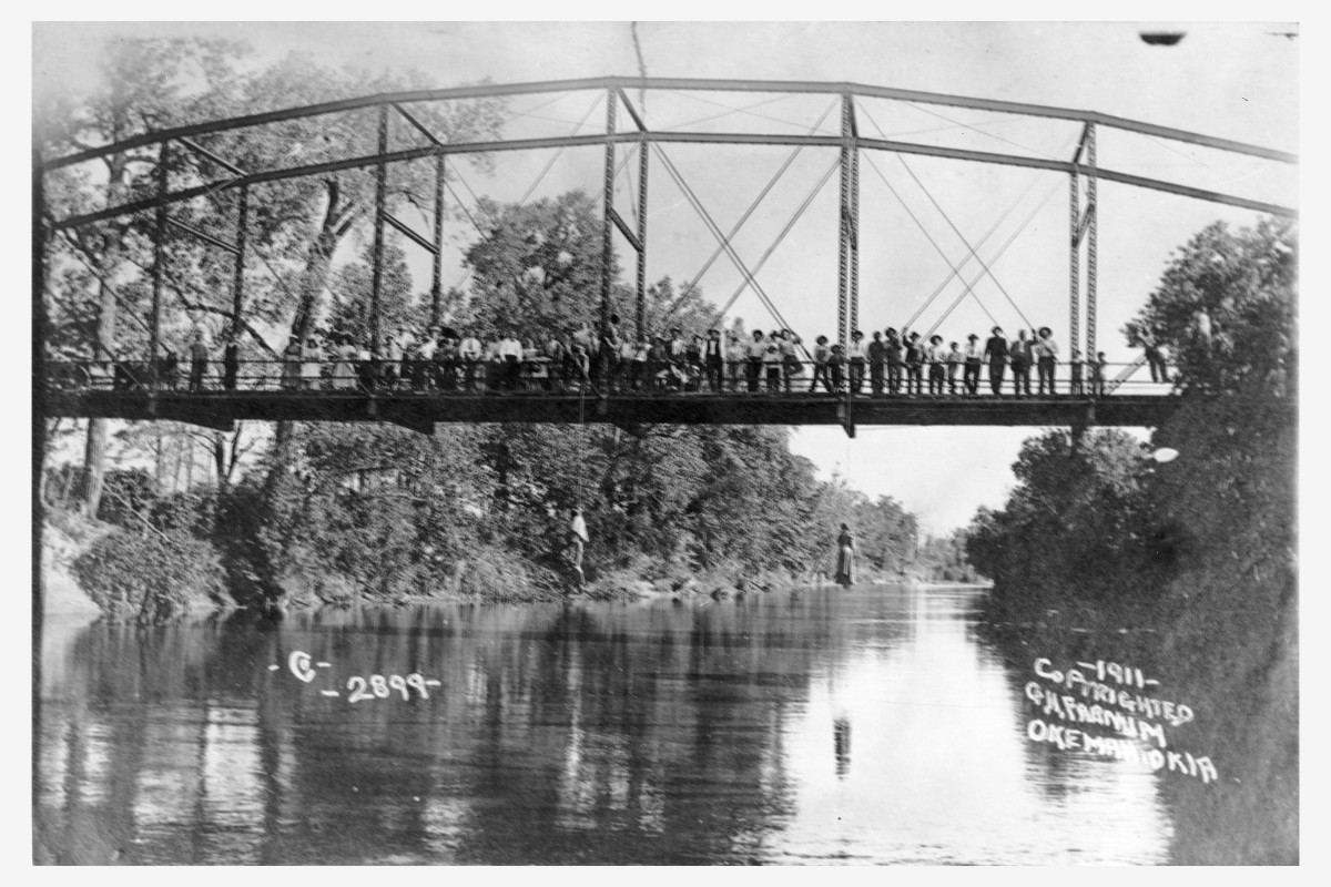 The lynching of Laura Nelson and her son, L.D. Nelson.  Either Laura or L.D. killed a sheriff's deputy; they were taken from the county jail and lynched.  Laura's baby, Carrie, lay on the river bank while her mother and brother were lynched.