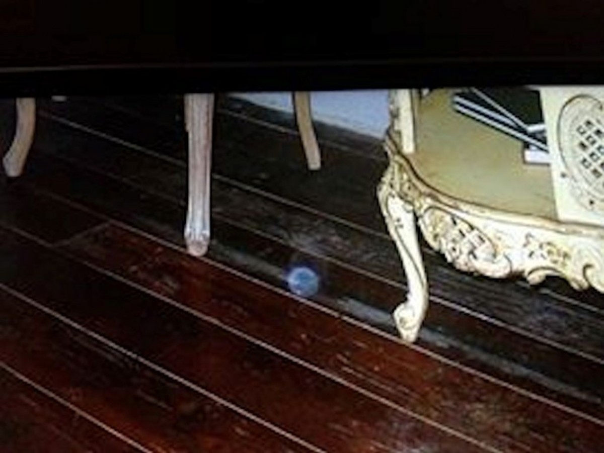 Blue orb under table