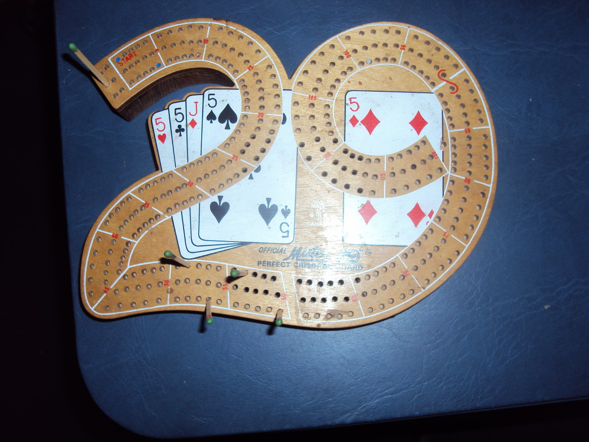 "This is the not-to-be-bored Cribbage board. Remember that ""Practice makes perfect."""