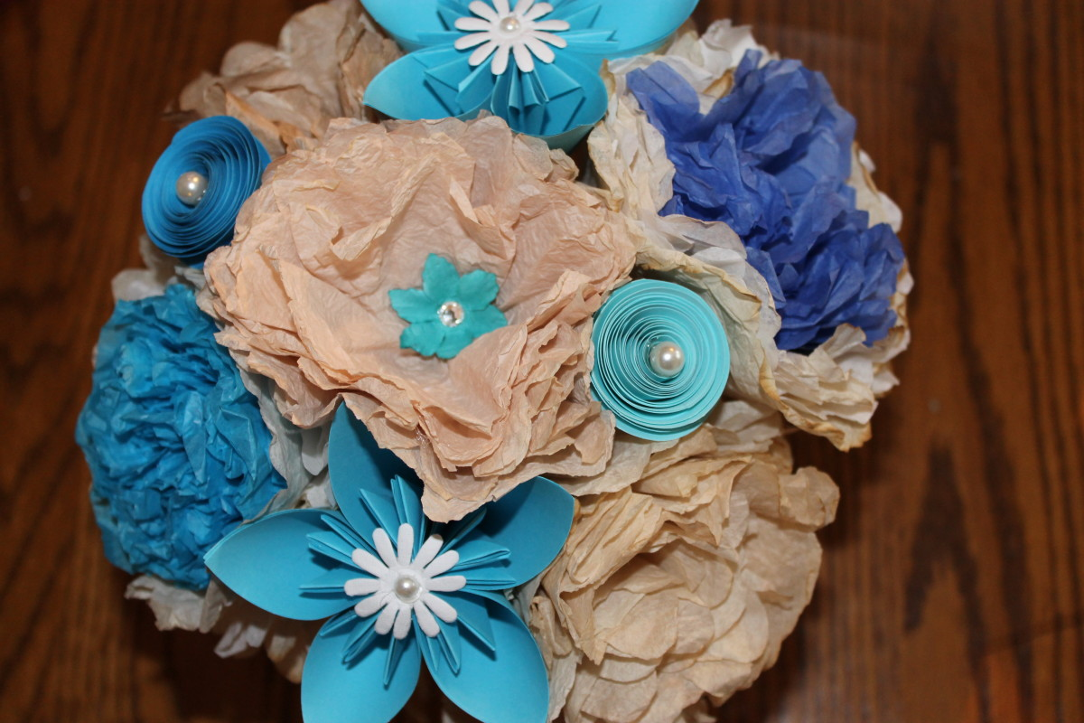 A paper flower bouquet using three types of flowers.
