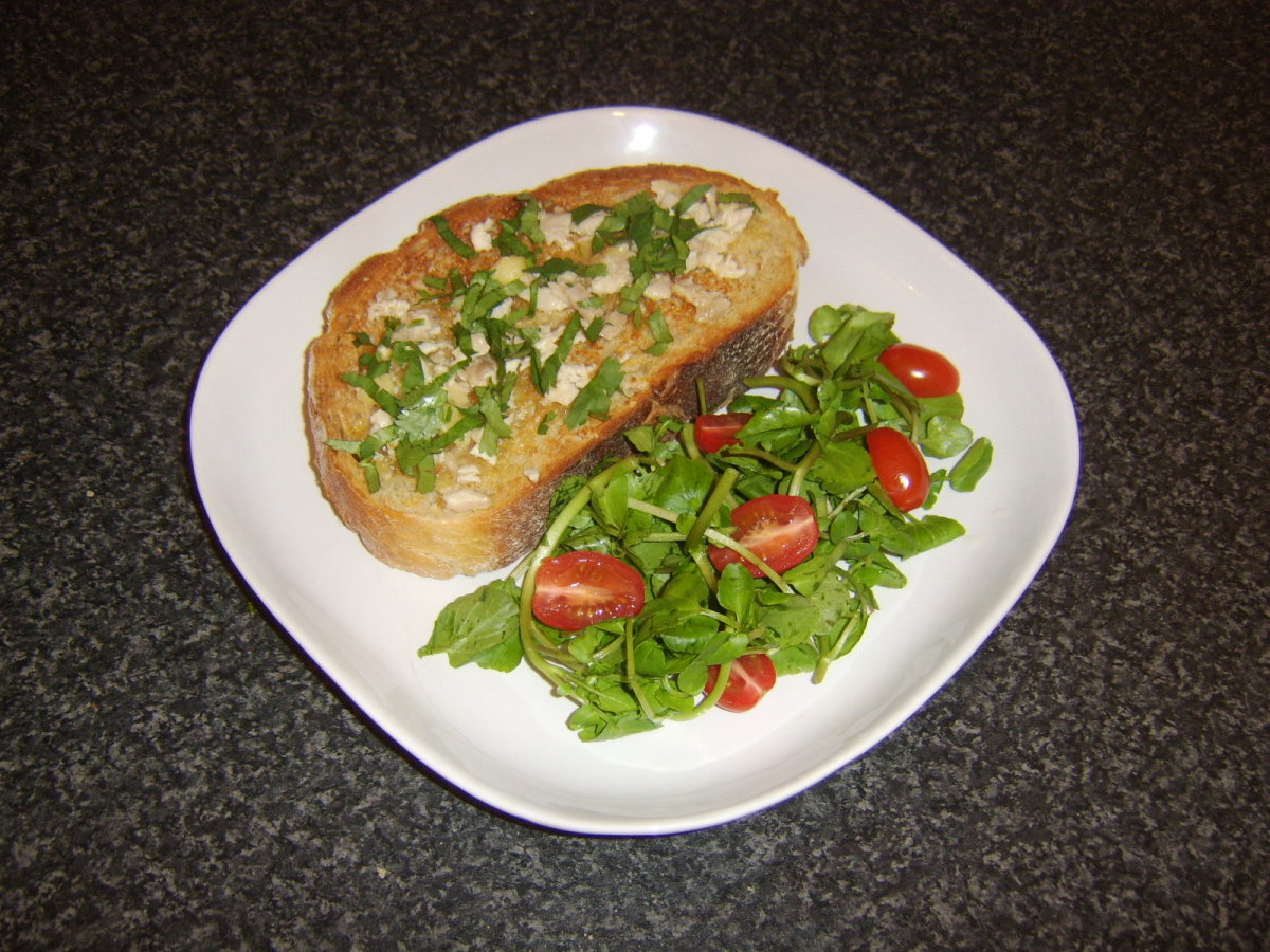 Chicken butter is spread on hot toast and served with a simple salad