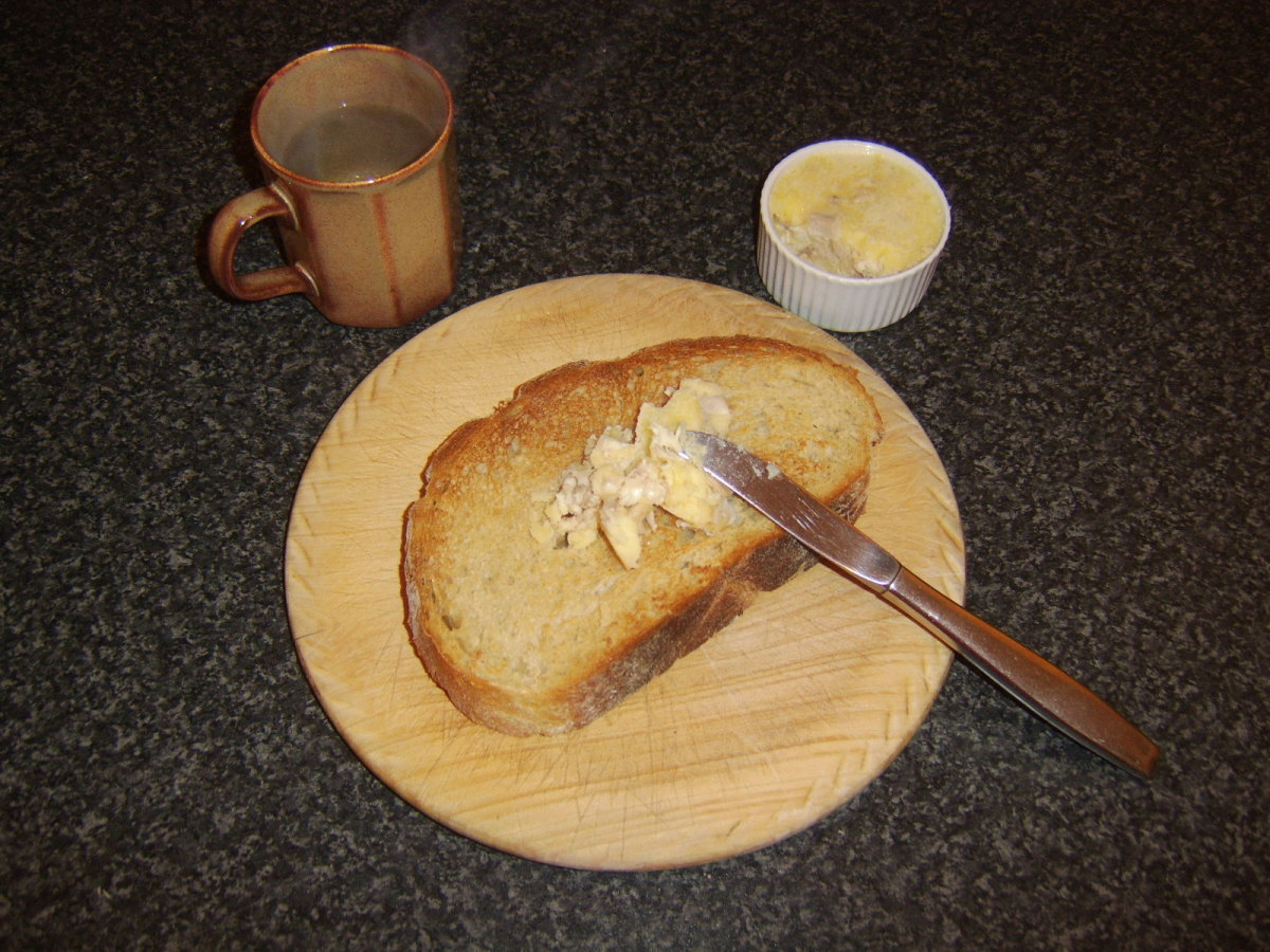 Chicken butter is spread on hot toast