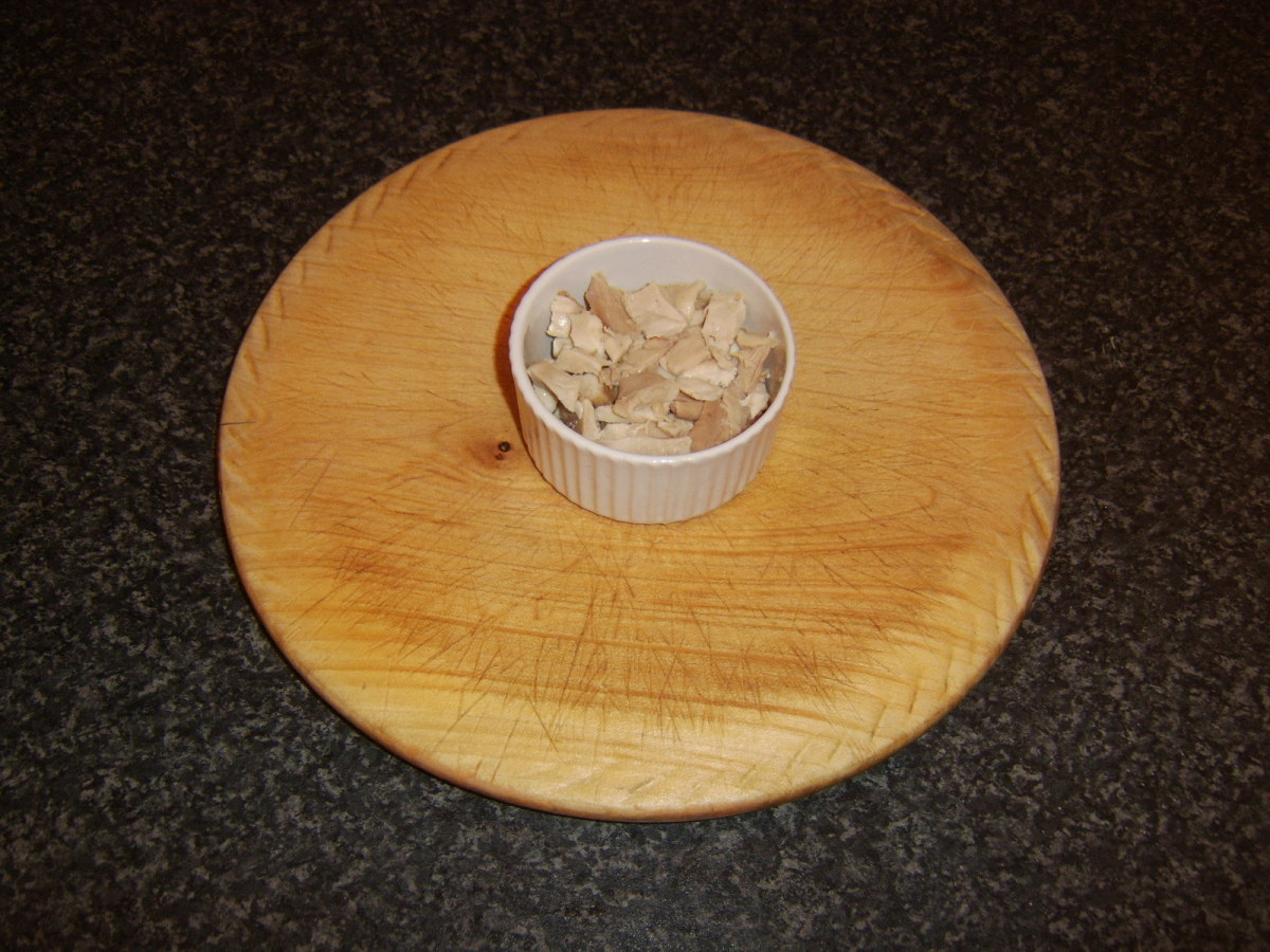 Chicken leg meat is added to small ramekin