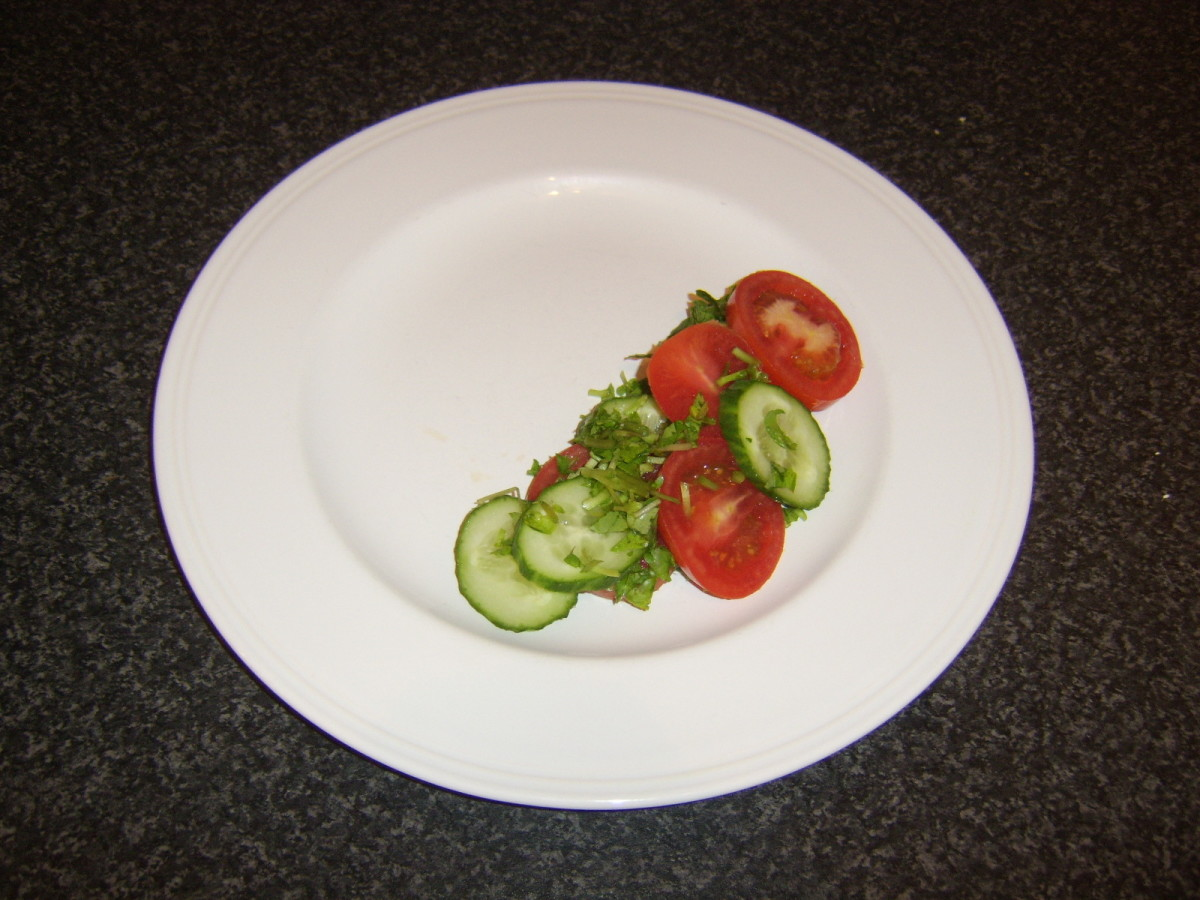 Side salad is arranged on serving plate