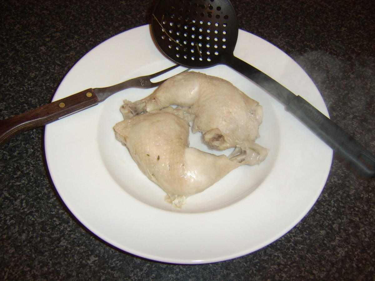 Chicken legs are removed from the poaching water