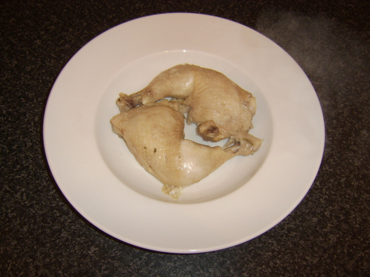 Perfectly poached whole chicken legs