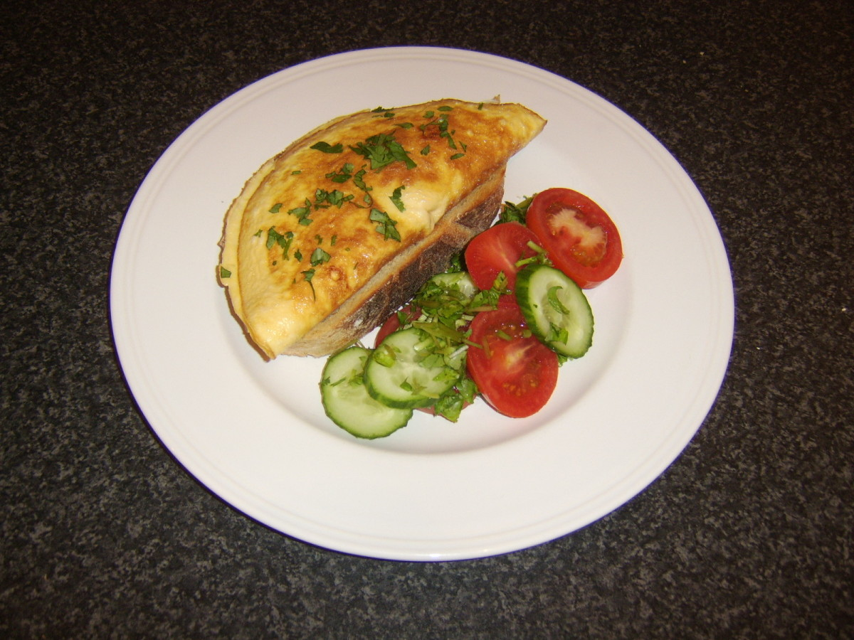 A poached chicken filled omelette, served on toast with a simple salad
