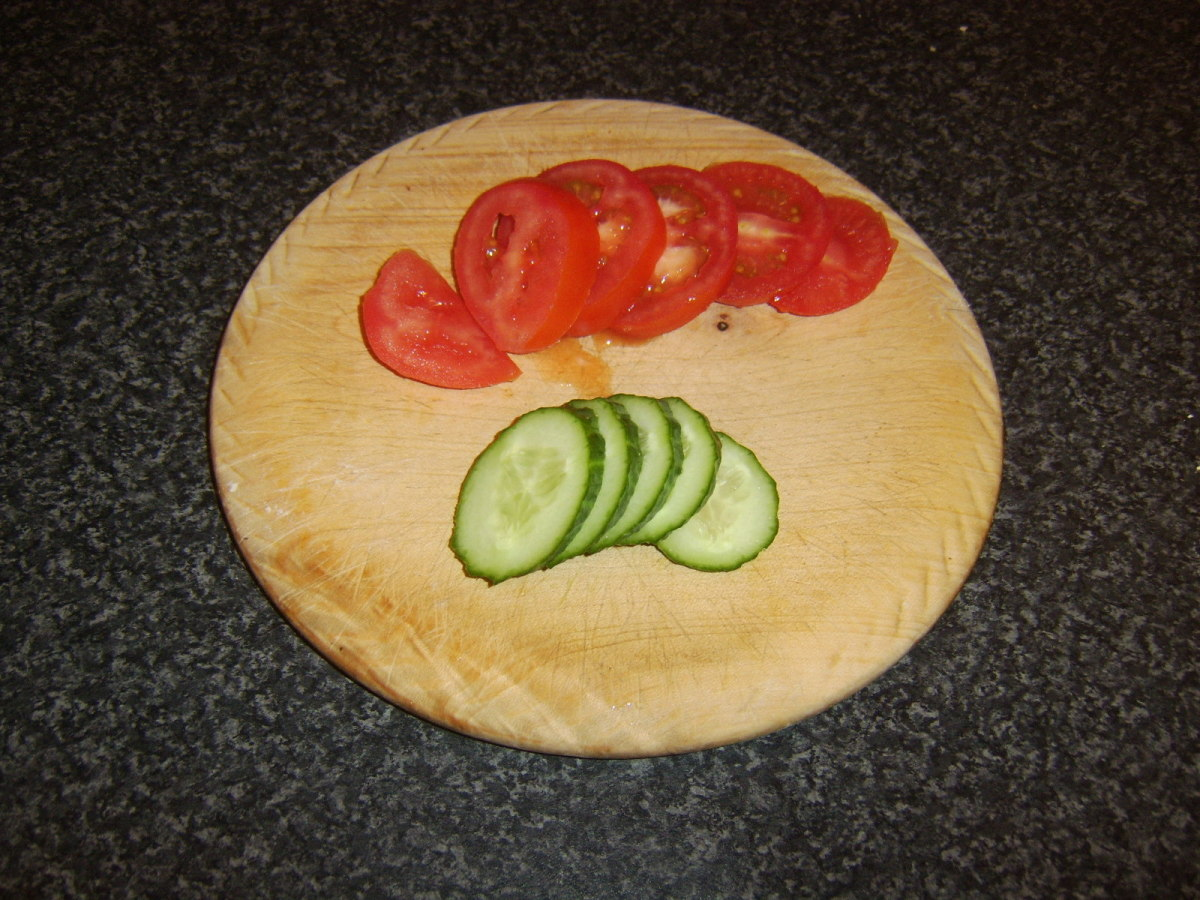 Tomato and cucumber is sliced for salad