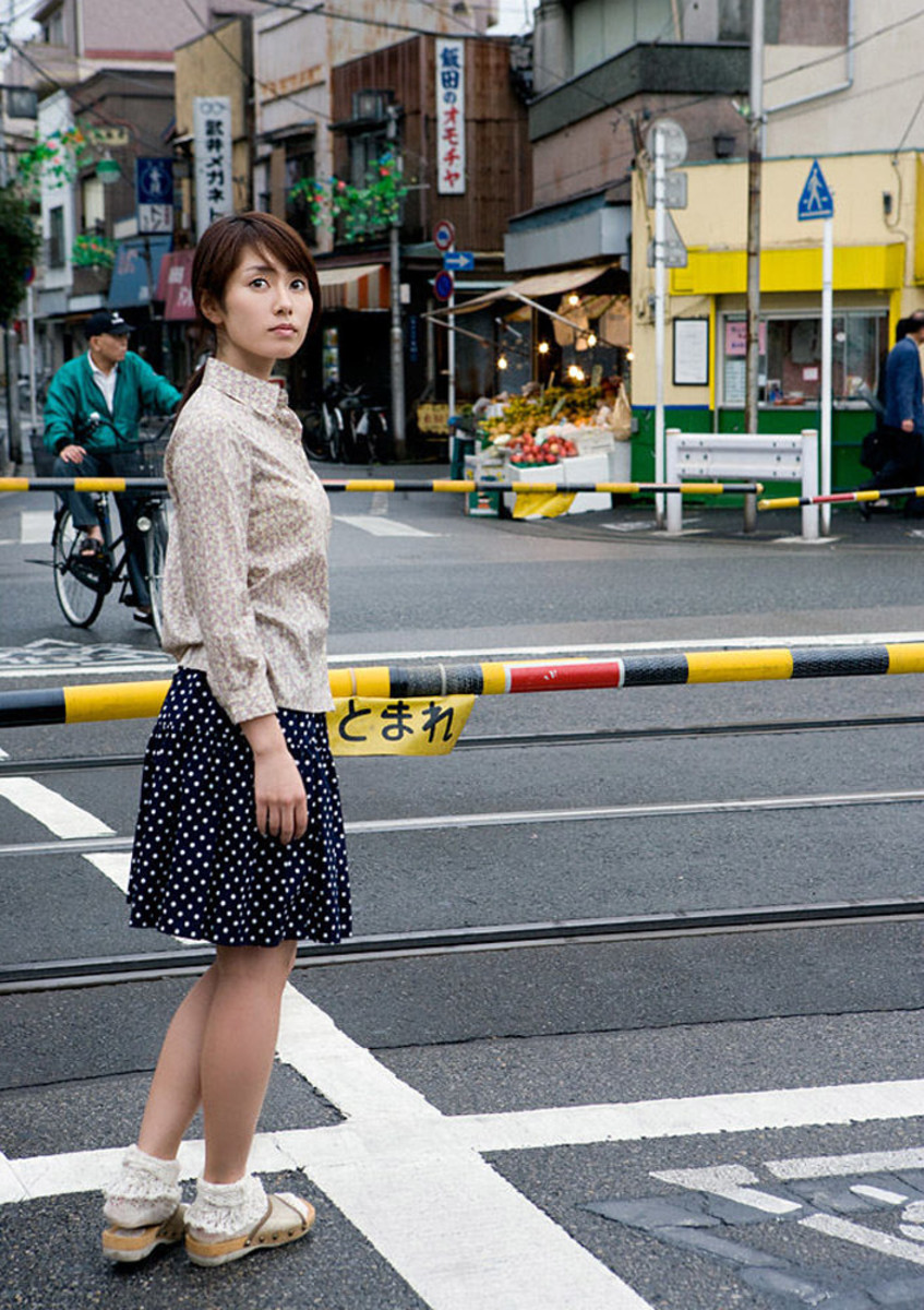 Momoko Tani walking on the streets of Japan.