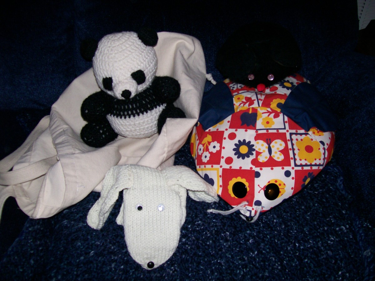 Panda toy (sitting on a canvas bag), knit dog puppet (my own adaption from old pattern), fabric mouse from sewing pattern circa 1970s-80s.