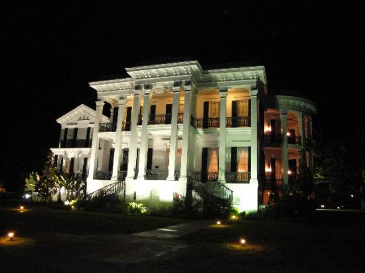 Nottoway Plantation lit up during the evening.