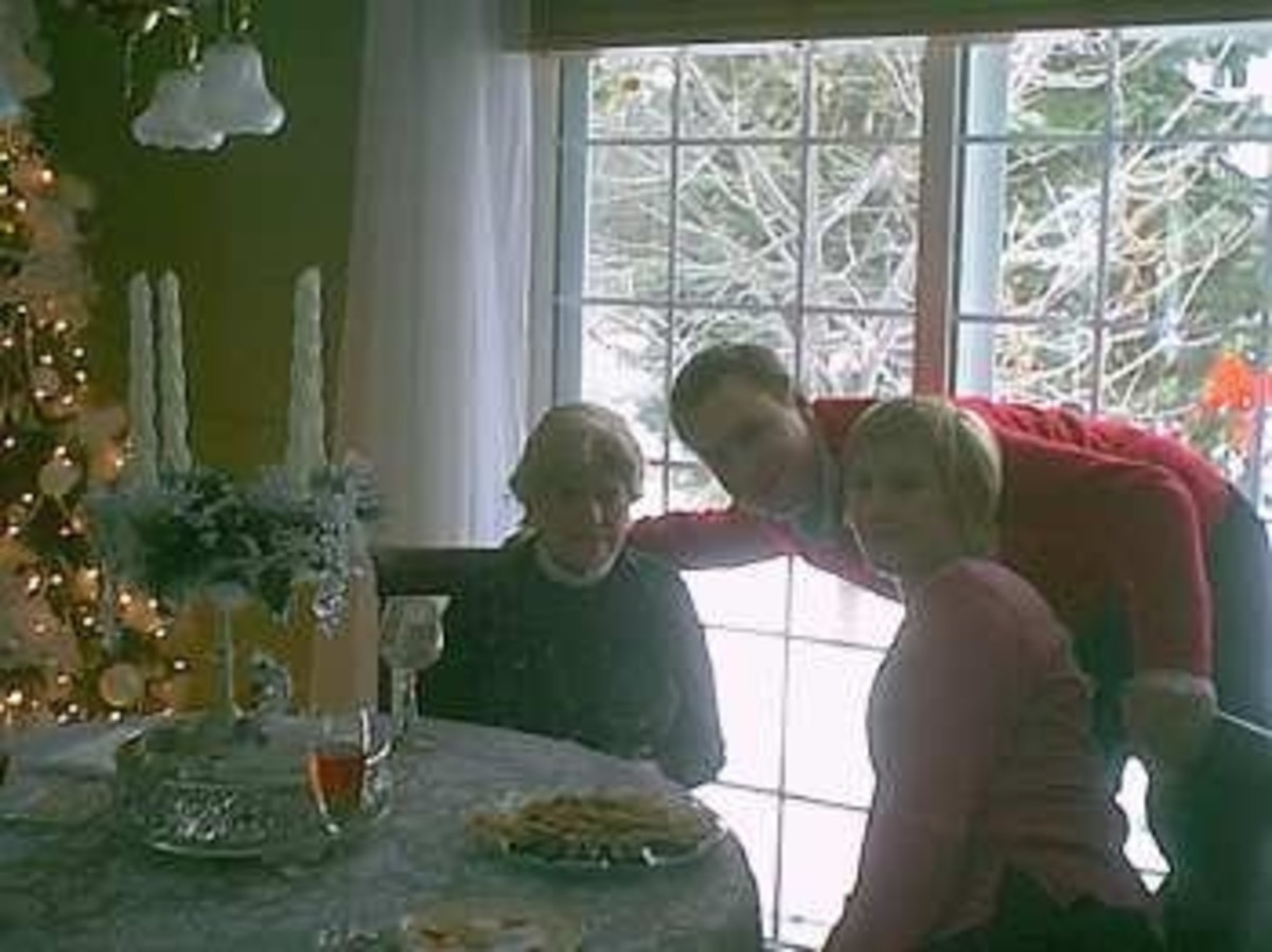 Frances enjoying Christmas with Grandson Eric, and his wife Liz...