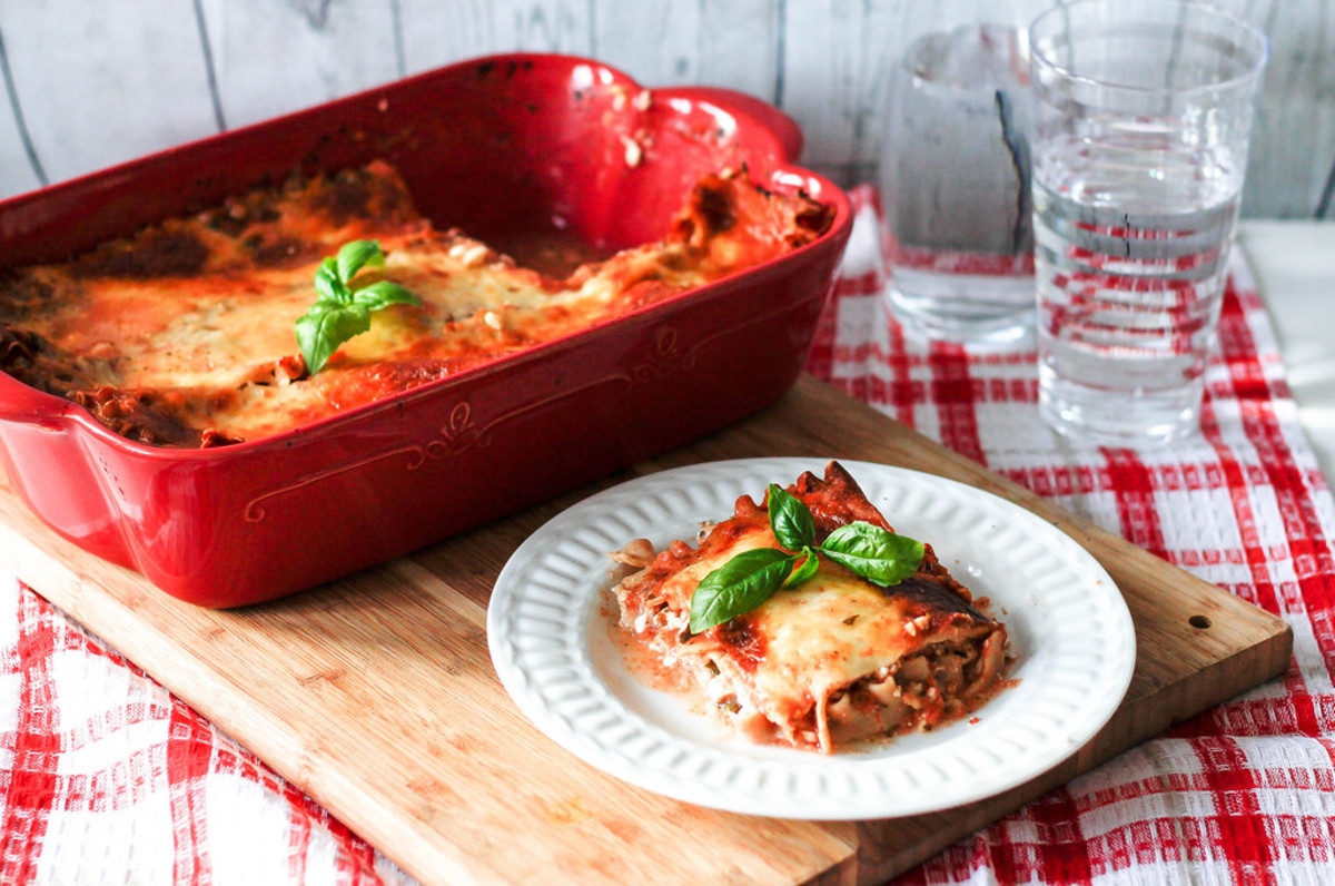 Lasagna topped with fresh basil.
