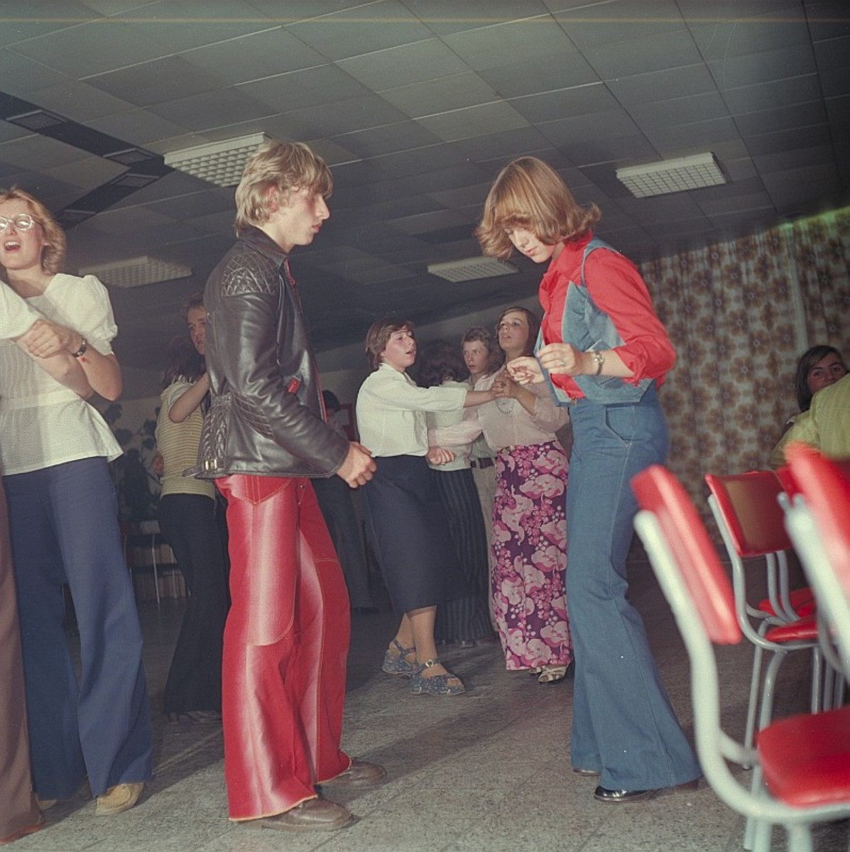 Flared jeans and trousers were popular with both sexes as can be seen at this German disco in 1977
