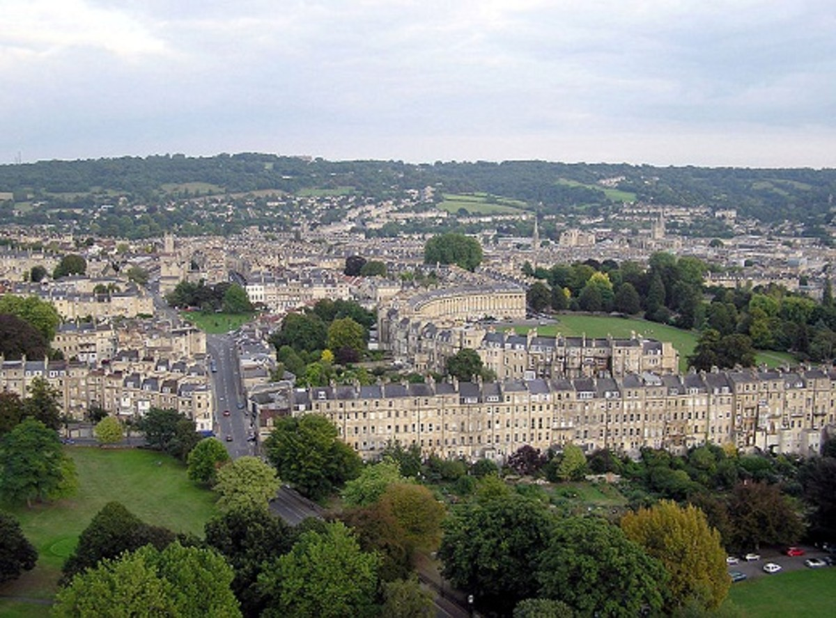 An aerial view of the city of Bath with a clear view of the famous Crescent.