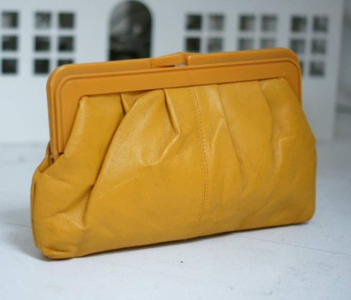 A very cool clutch bag, in Yellow leather, dating to circa 1984.