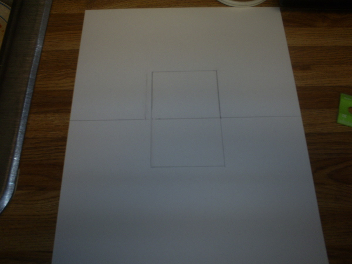 Use the ruler to also draw a square on the bottom half of the page.