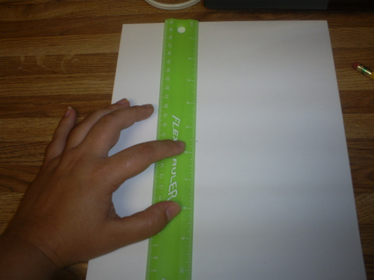 Use a ruler to measure to the center of the page.
