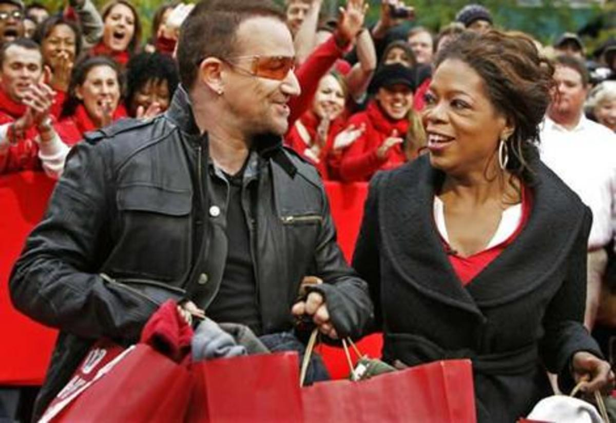 Happy to give: Celebrity fundraisers Bono and Oprah Winfrey promoting the singer's new project to fight AIDS in Africa. Photo: AP
