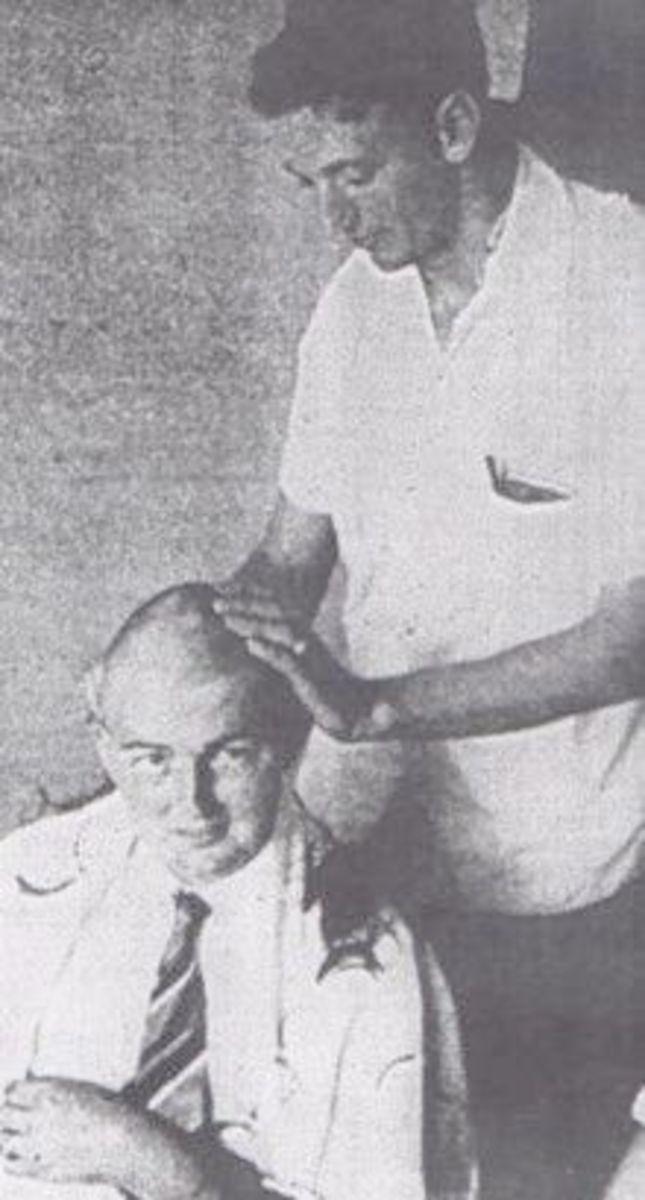 Banks McFadden shaving a Freshman Bill Crenshaw's head.