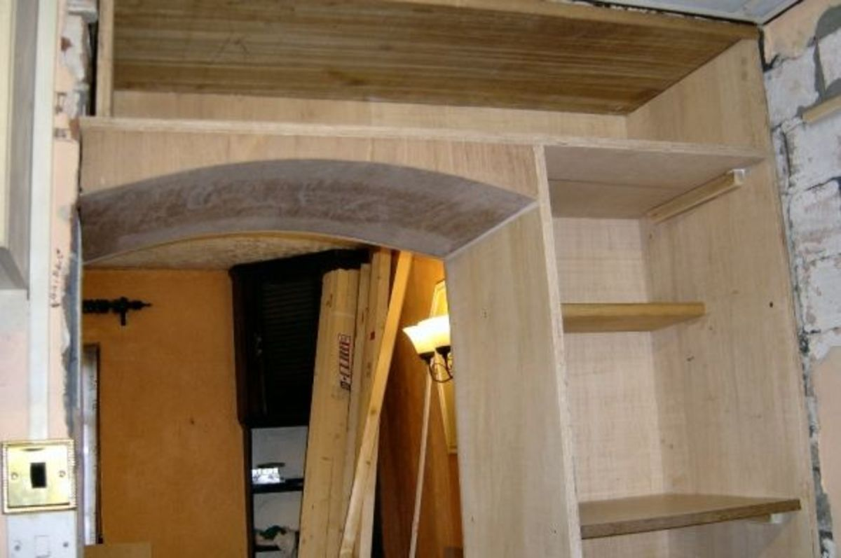 Replacing bricked Arch in doorway to kitchen with a smaller opening, and using the extra space for a built-in Larder.