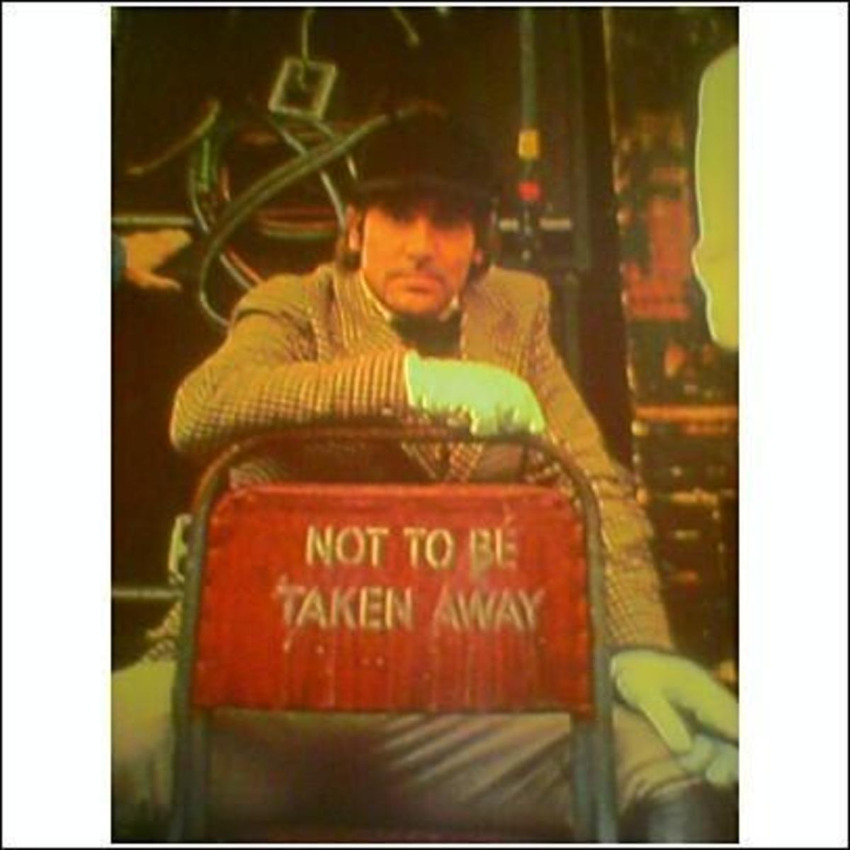 "Keith died two weeks after the release of The Who's album ""Who Are You."" This photo from that album cover. Sadly... I think the words on the chair say it all."
