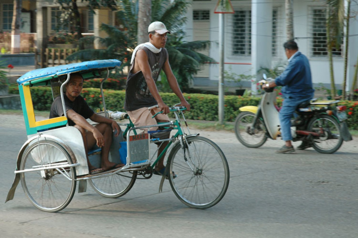 A Pedicab is a bicycle with a sidecar.