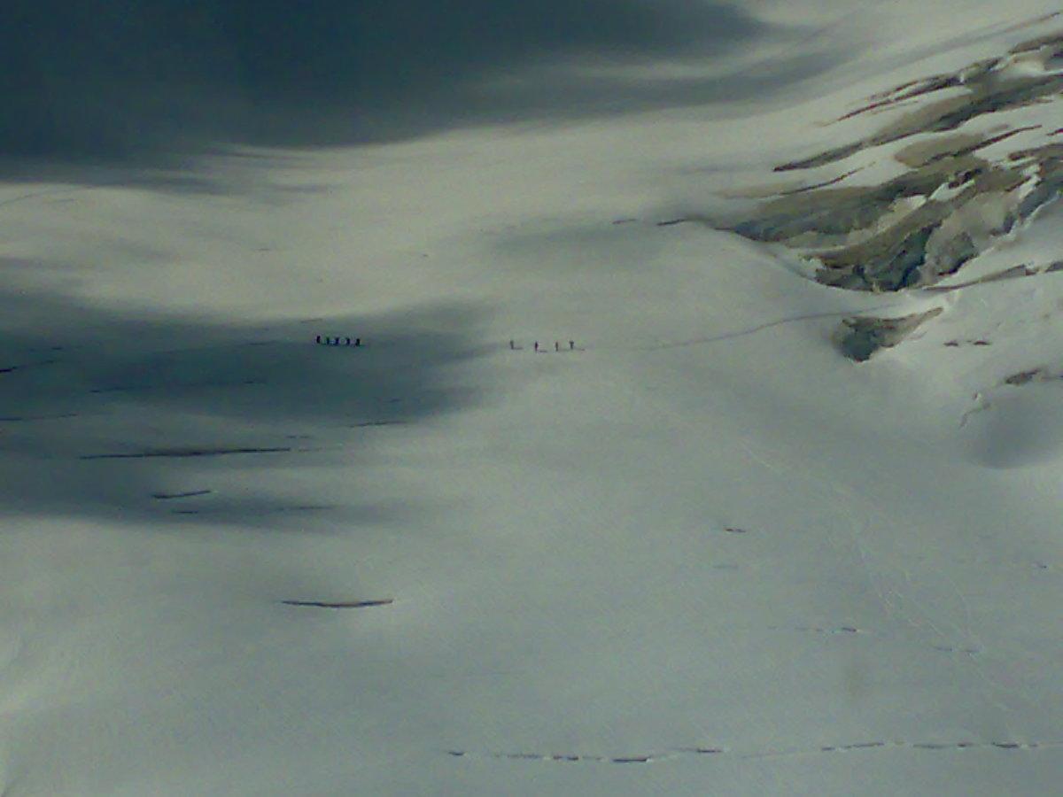 Mountaineers Below Us On The Dangerous Ice Field