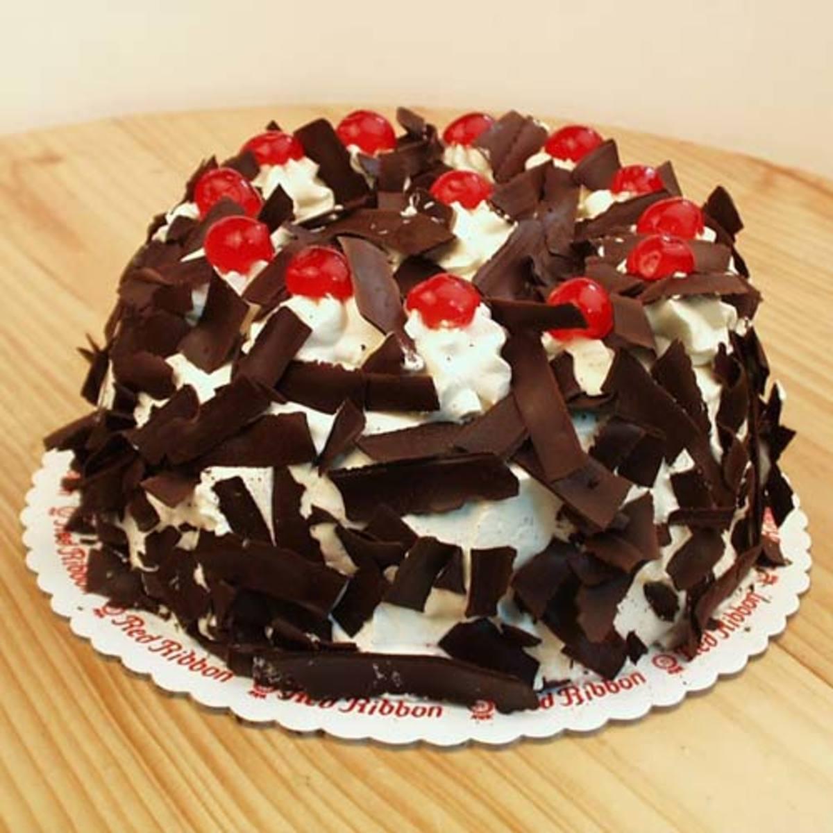 Red ribbon black forest super dark cake