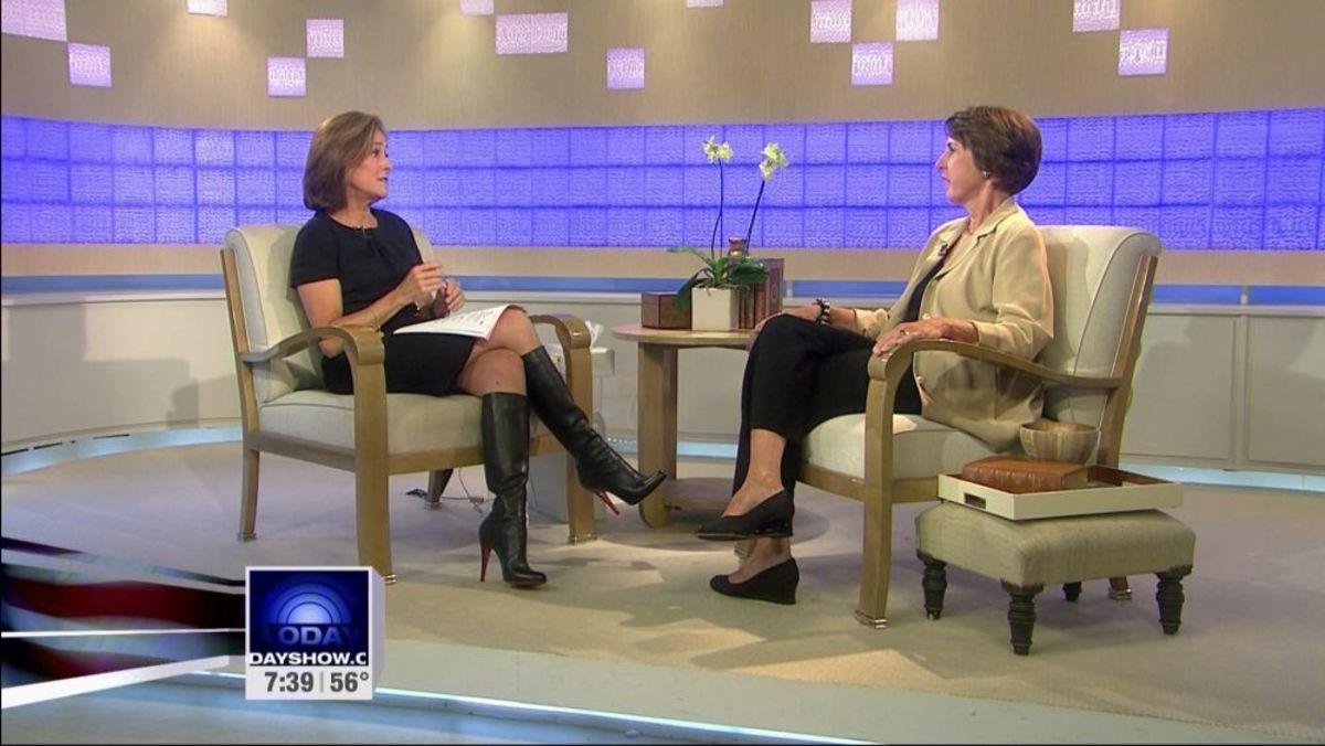 Meredith Viera crossed legs in high heel boots