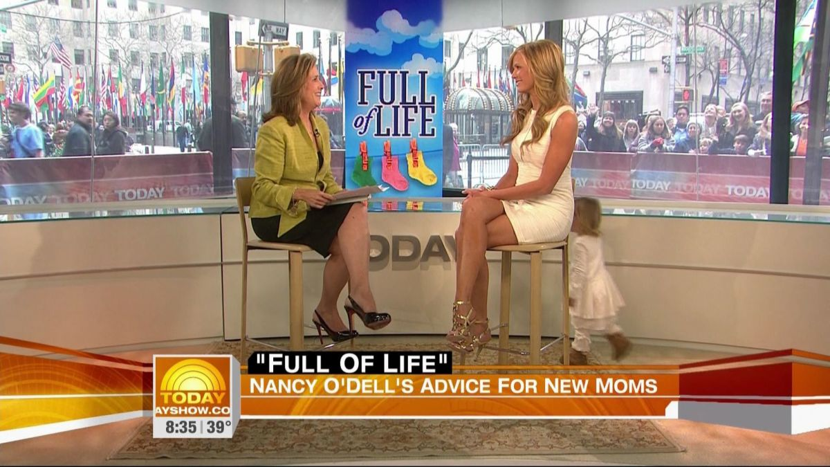 Meredith Viera interviewing Nancy O'dell. Each are wearing sexy high heels.