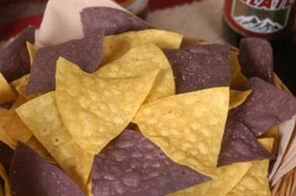Some white and blue corn tortilla chips.