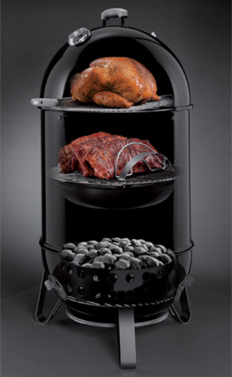 Cutaway showing inside a smoker grill from Weber.