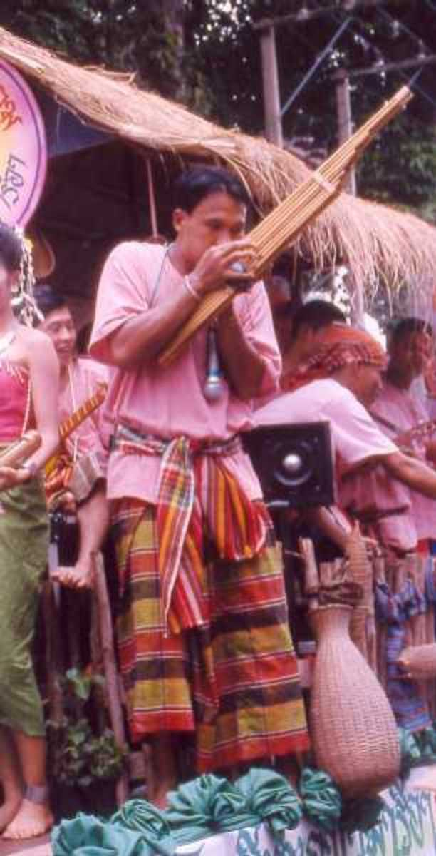 Traditionally dressed khene player