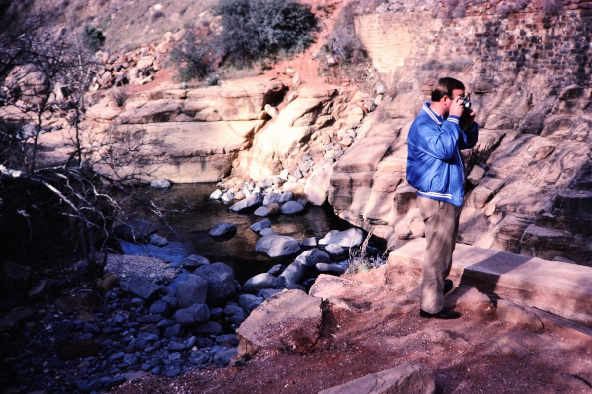 I'm taking a pictuce of my husband taking pictures in Oak Creek Canyon.