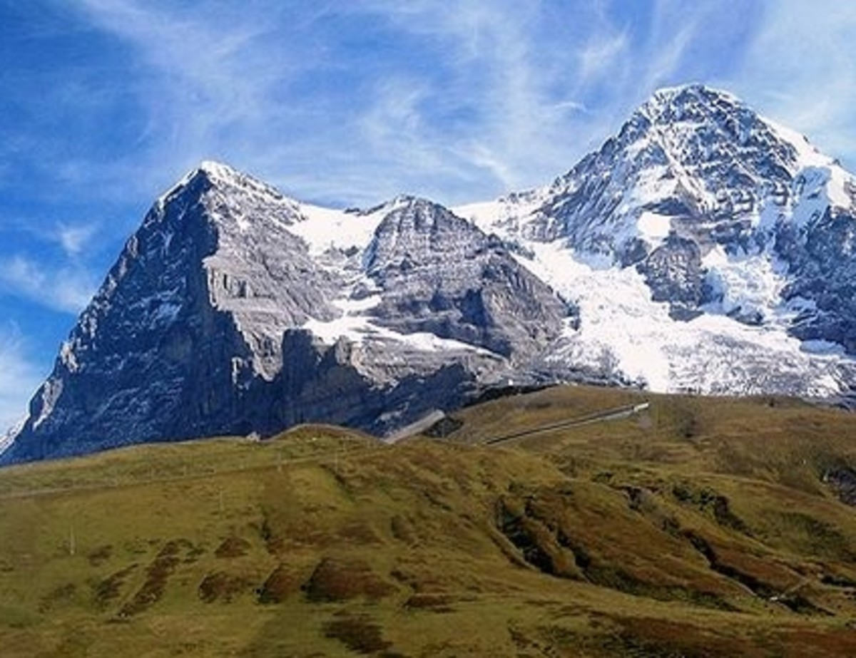 The Eiger North Face and the Moench towering above the alpine meadows of the Kleine Scheidegg. Photo by cable1