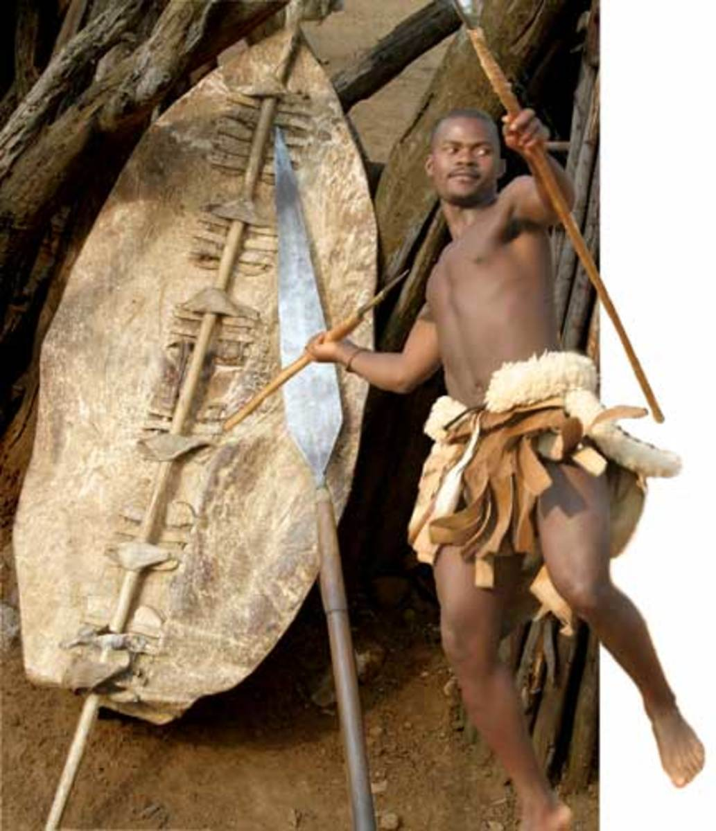 "The spear in the background with a large blade might be more closer to the ""Ixwa"", with an even shorter wooden or steel handle. It was indeed menacing and intimidating"