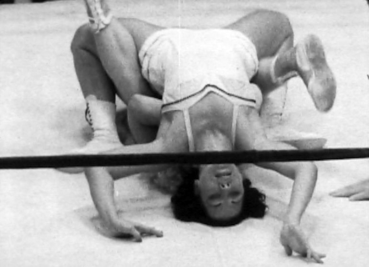 June Byers going for a pin on Penny Banner
