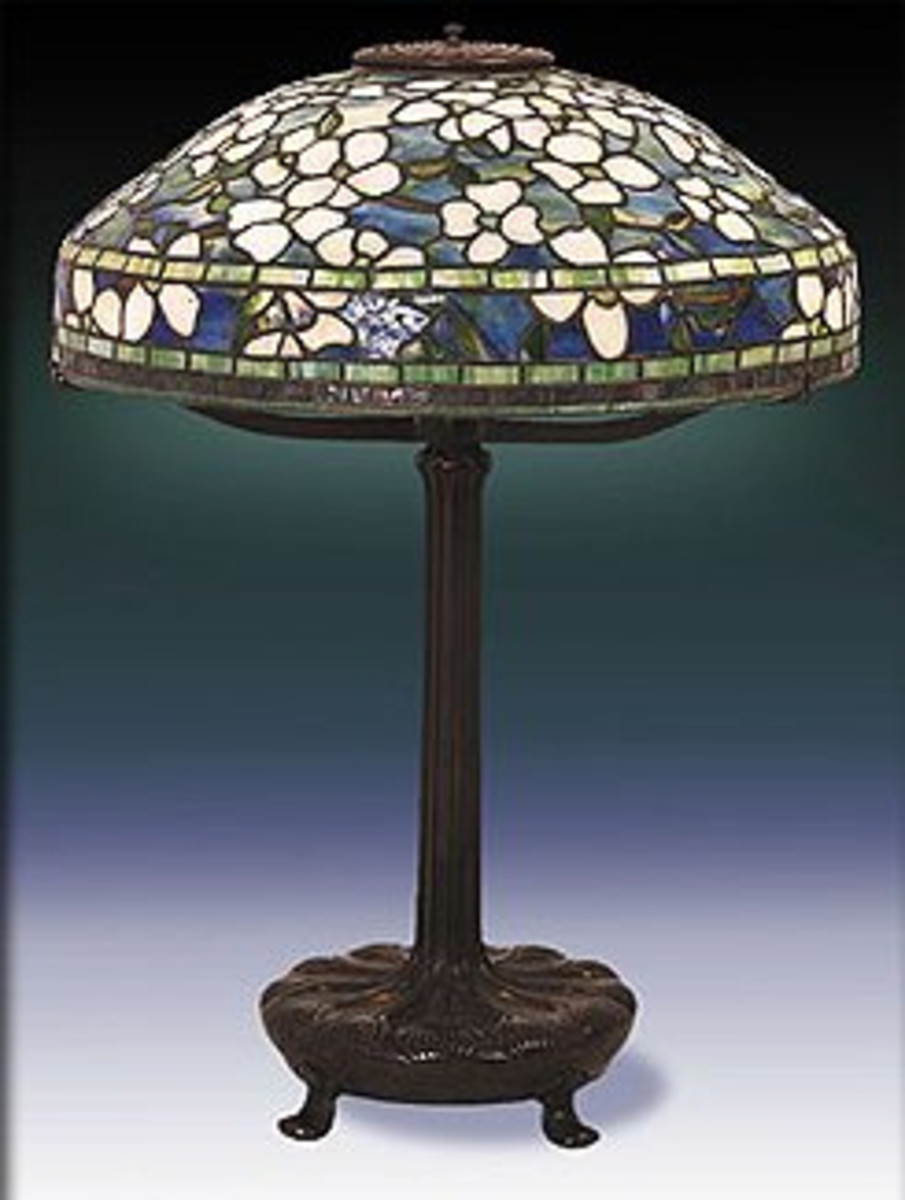 """Example of an authentic Tiffany Table Lamp featuring the """"belted"""" dogwood pattern."""