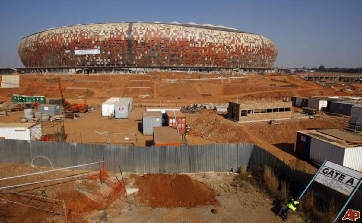 FNB or Soccer City City modelled like an African Calabash being prepared for 2010 next to Soweto Highway