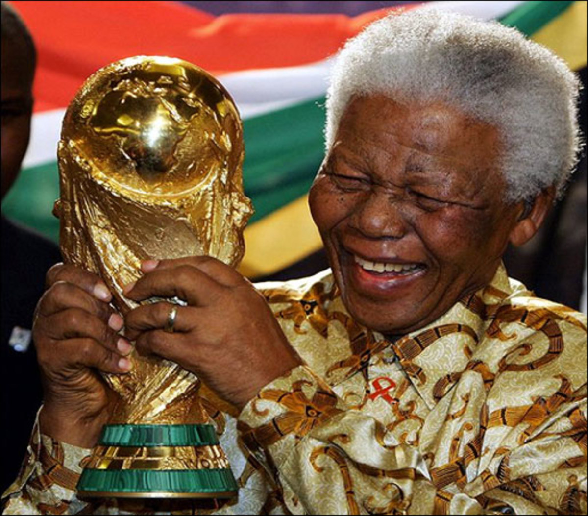 Nelson  Rolihlahla Madiba Mandela holding a model of the World Cup
