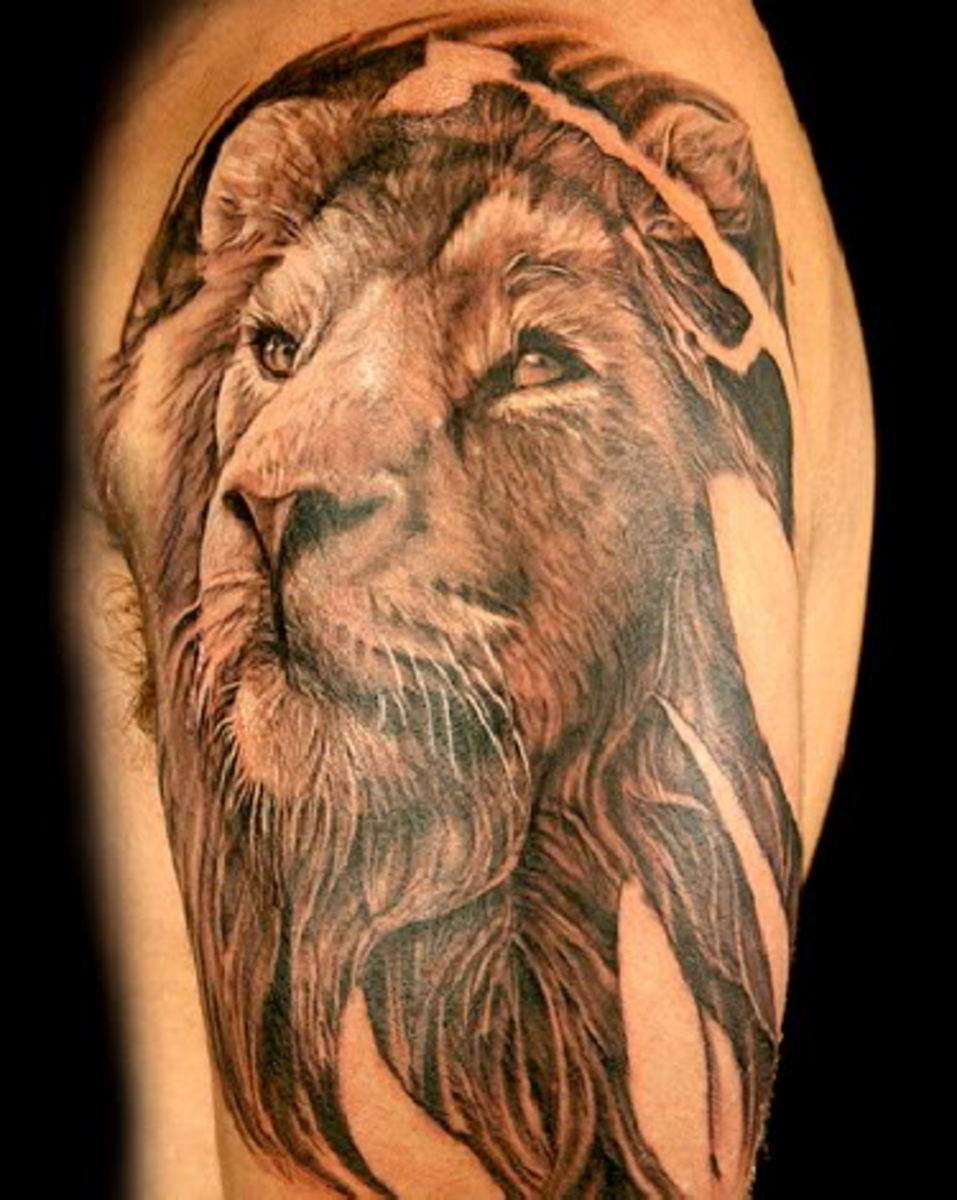 """I find this tattoo calming.  The lion seems wise and reminds me of Aslan from """"The Lion, The Witch And The Wardrobe""""."""