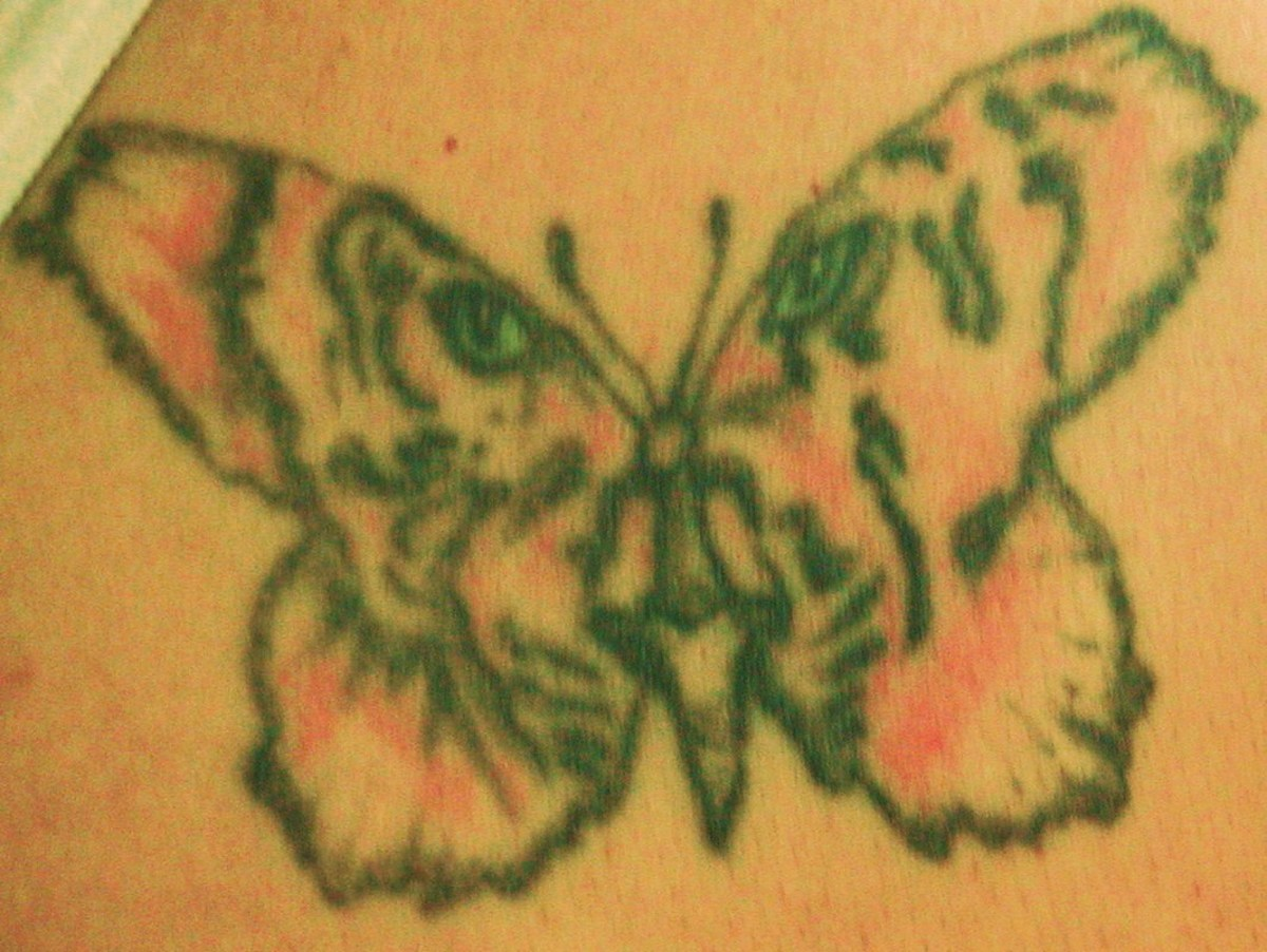 This is my tiger tattoo, shaped as a butterfly.  The colors have faded a little, but I still love it!